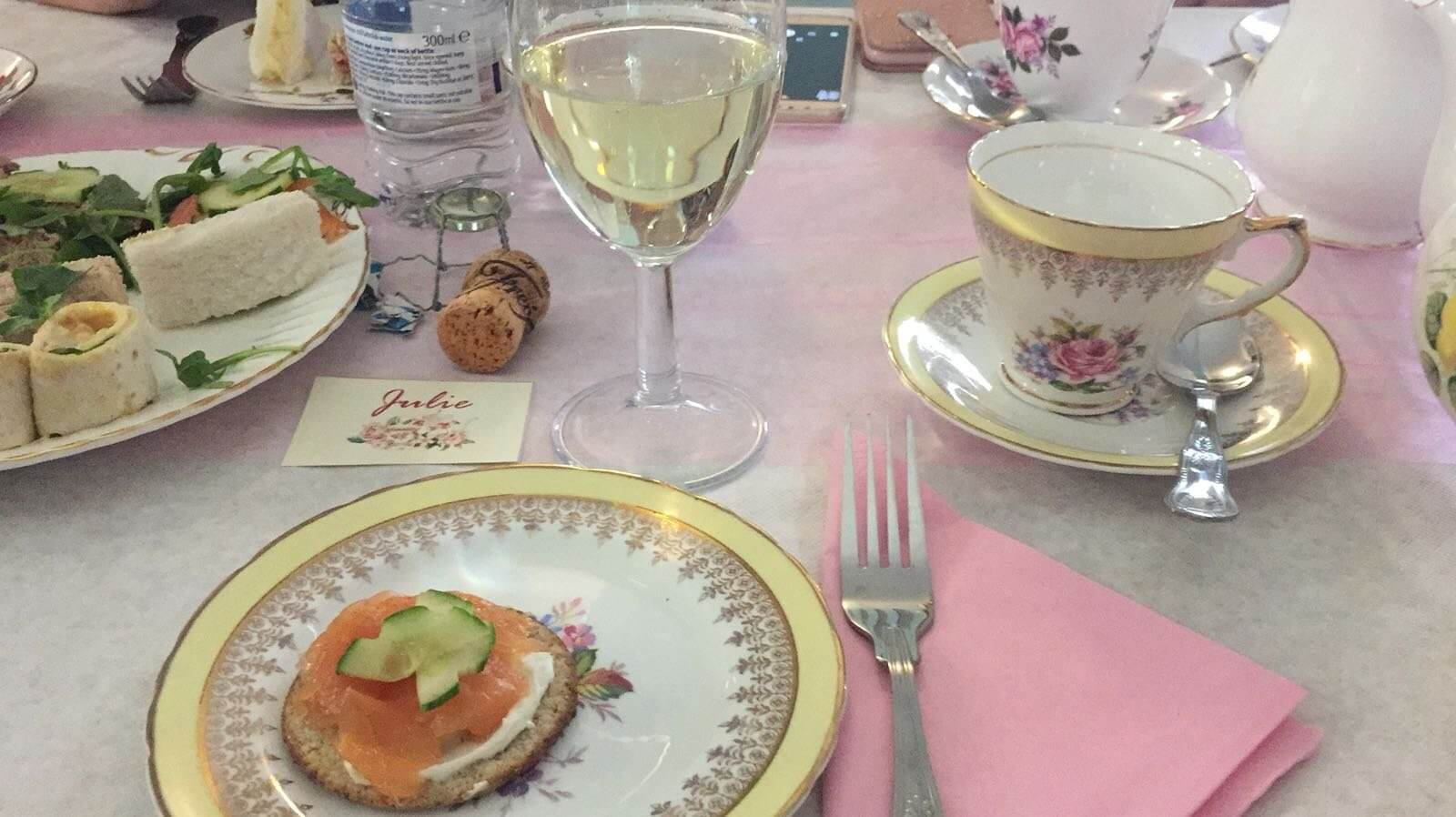 Photos shows smoked salmon sandwiches on a vintage china plate